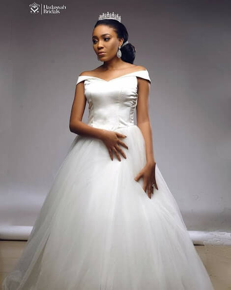 Satin Top Off Shoulder Ball Wedding Gown Available For Rent In Lagos