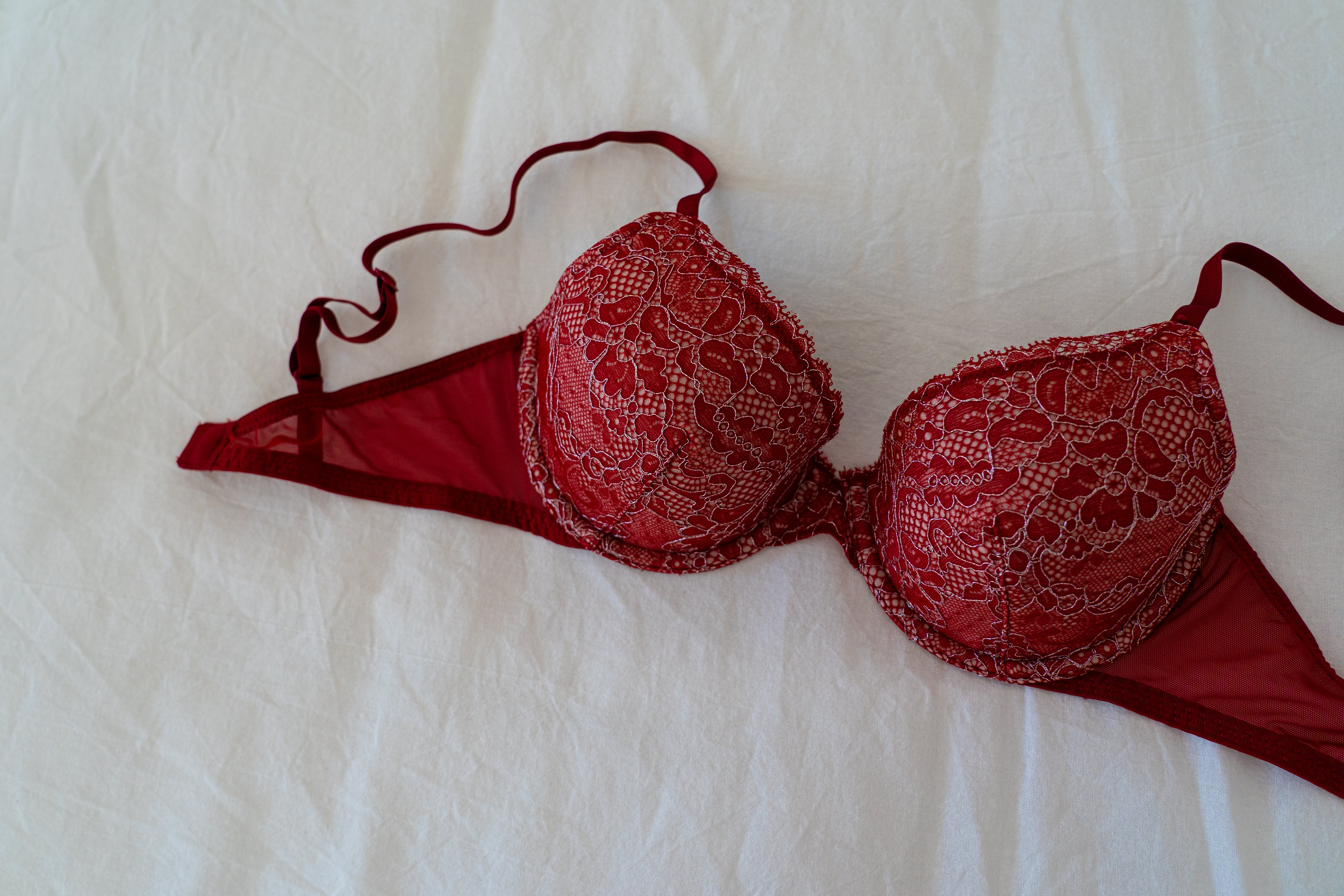 Red Brassiere on White Textile